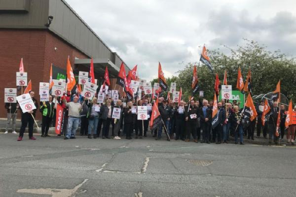 GMB fight back against Asda's plan to impose contract 6